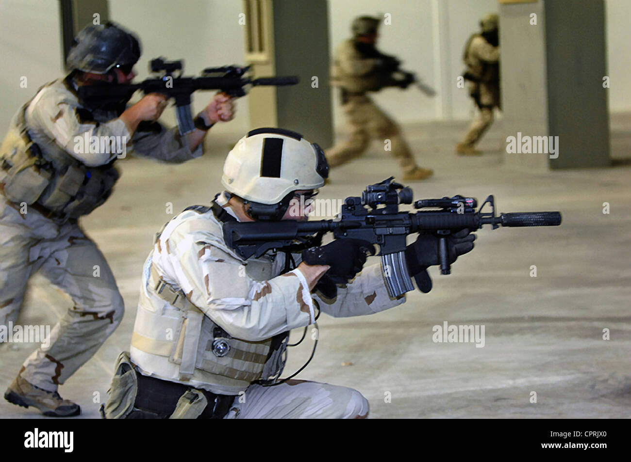 US Navy SEALs practice conduct participate in a tactical warfare training - Stock Image