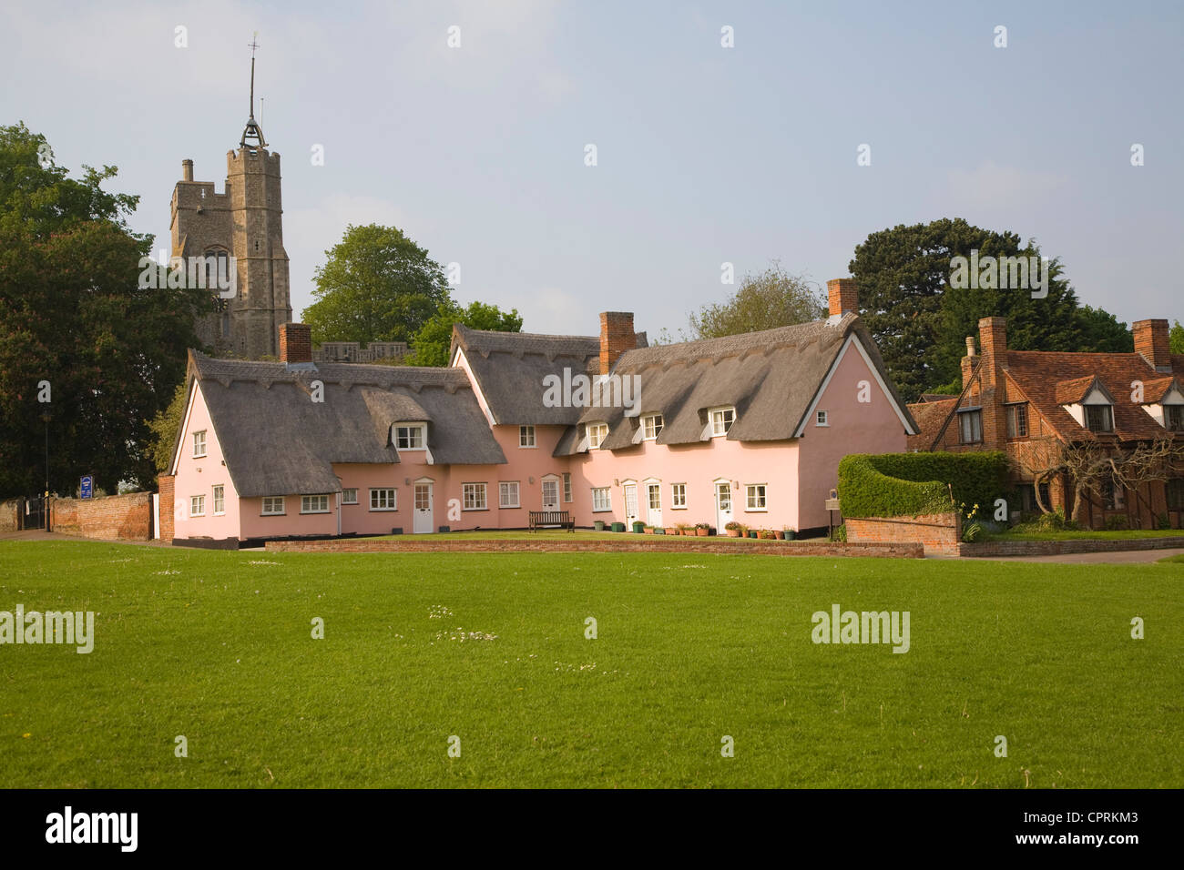 Pink cottages at Cavendish Suffolk England - Stock Image
