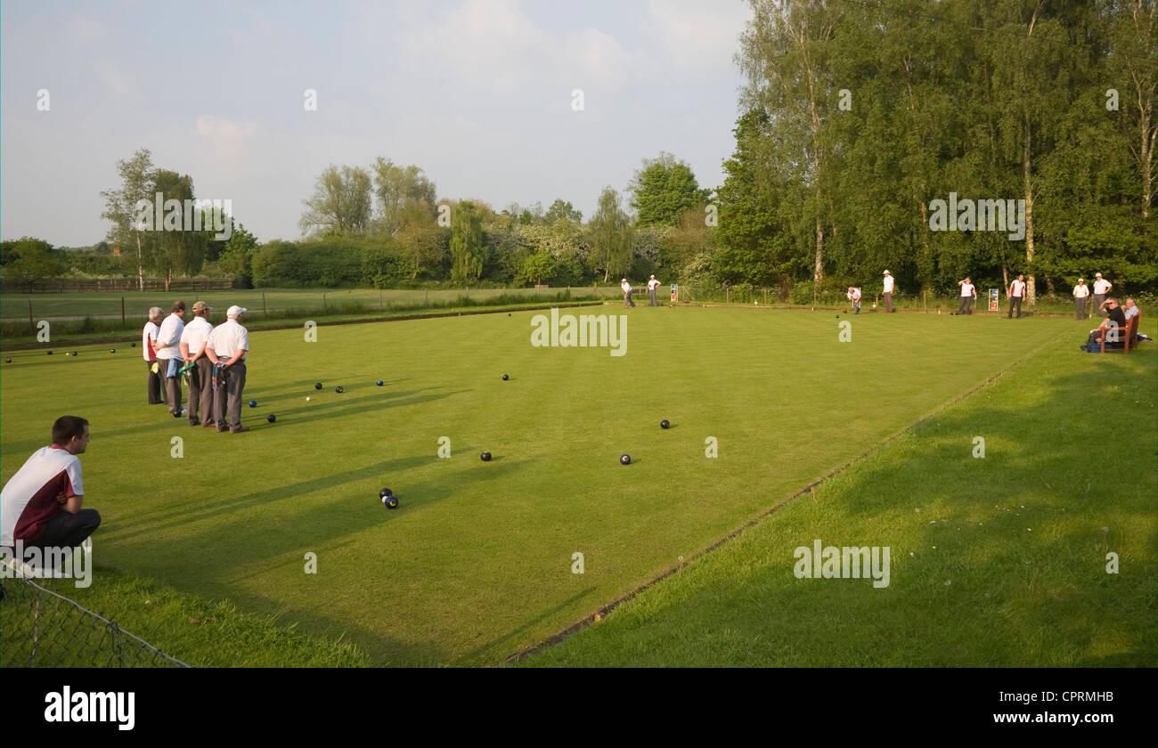 People playing lawn bowls Clare, Suffolk, England - Stock Image