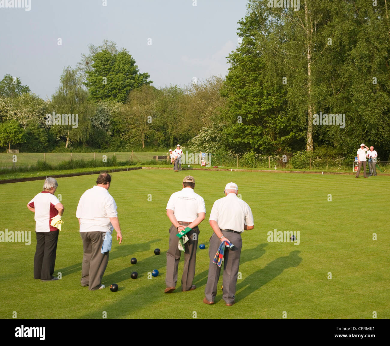 People playing lawn bowls at Clare, Suffolk, England - Stock Image