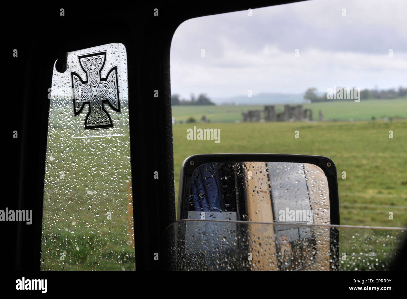View of Stonehenge from a camper van belonging to Druids supportive of Arthur Pendragons vigil at the ancient Wiltshire - Stock Image