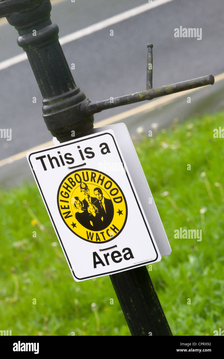 Neighbourhood Watch Area sign attached to an antique Victorian gas lamp post in Bristol UK - Stock Image