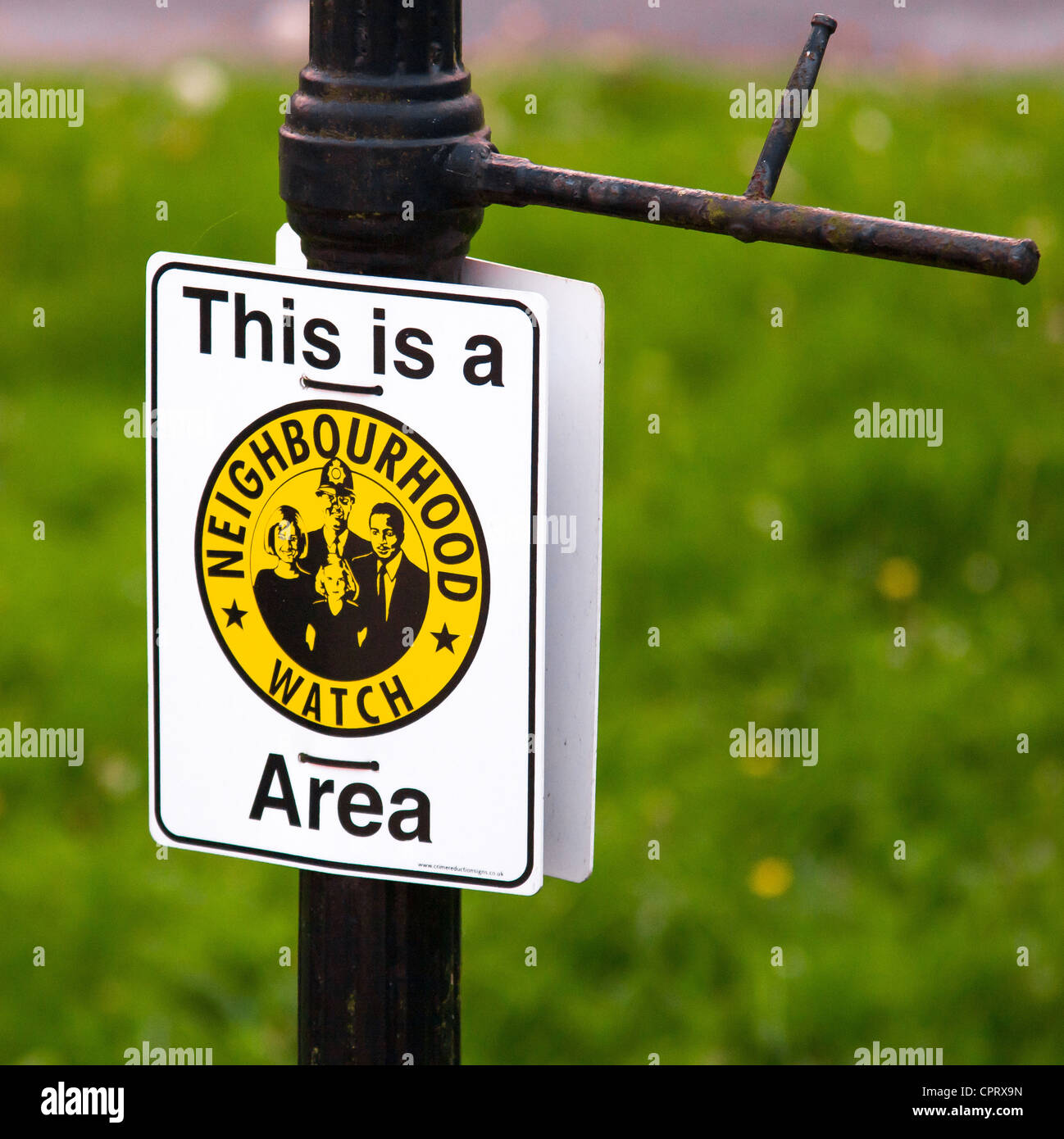 Neighbourhood Watch Area sign attached to a Victorian lamp post in a residential street UK - Stock Image
