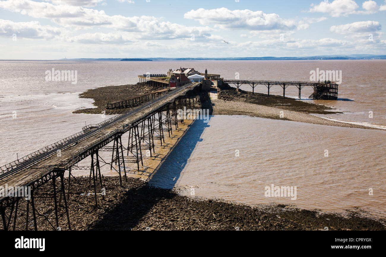 The derelict Birnbeck Pier Weston super Mare Somerset looking out over the Severn Estuary to South Wales - Stock Image