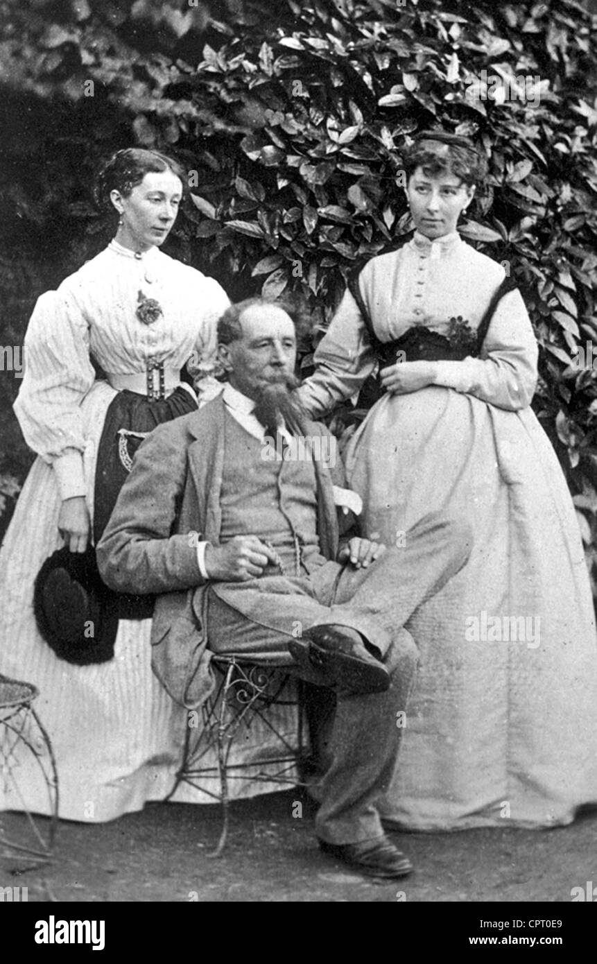 CHARLES DICKENS (1812-1870)  English writer  with daughters Marie at left and Katie at Gads Hill Place in 1865 - Stock Image