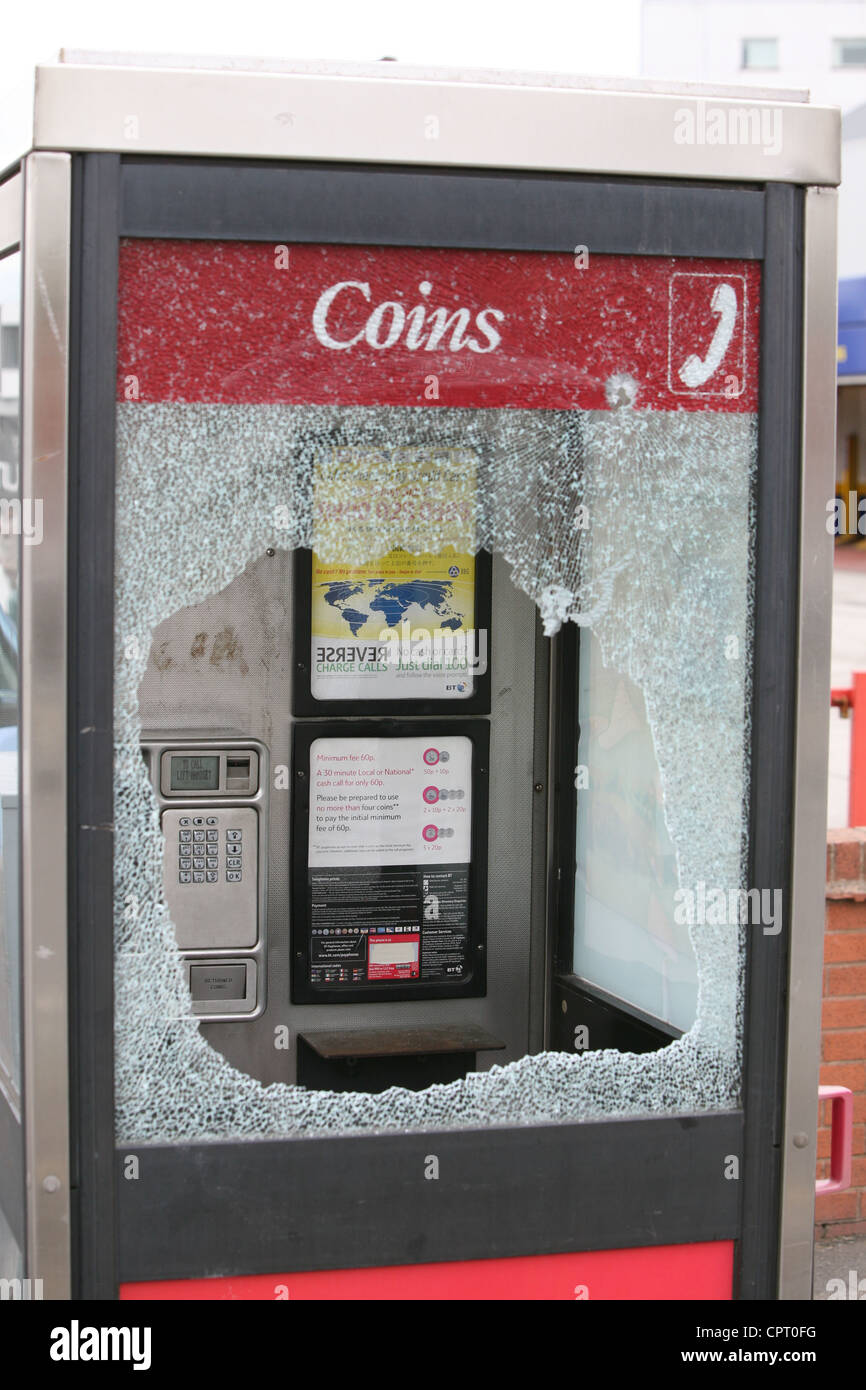 a telephone kiosk after being vandalised - Stock Image