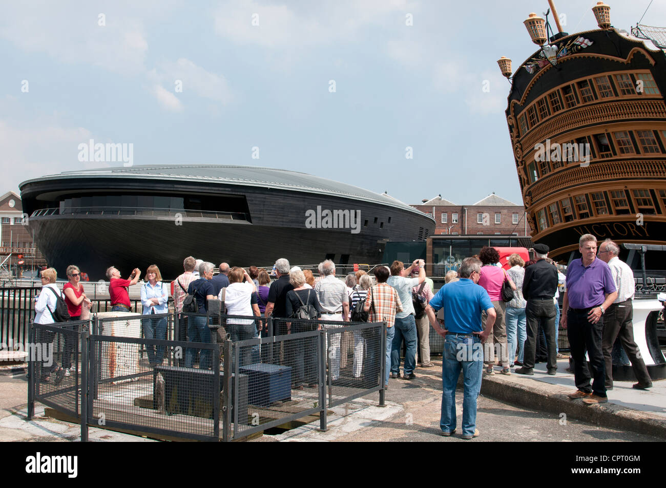 The new Mary Rose Exhibition Hall alongside HMS Victory in Portsmouth Historic Dockyard  southern England UK Opening Stock Photo