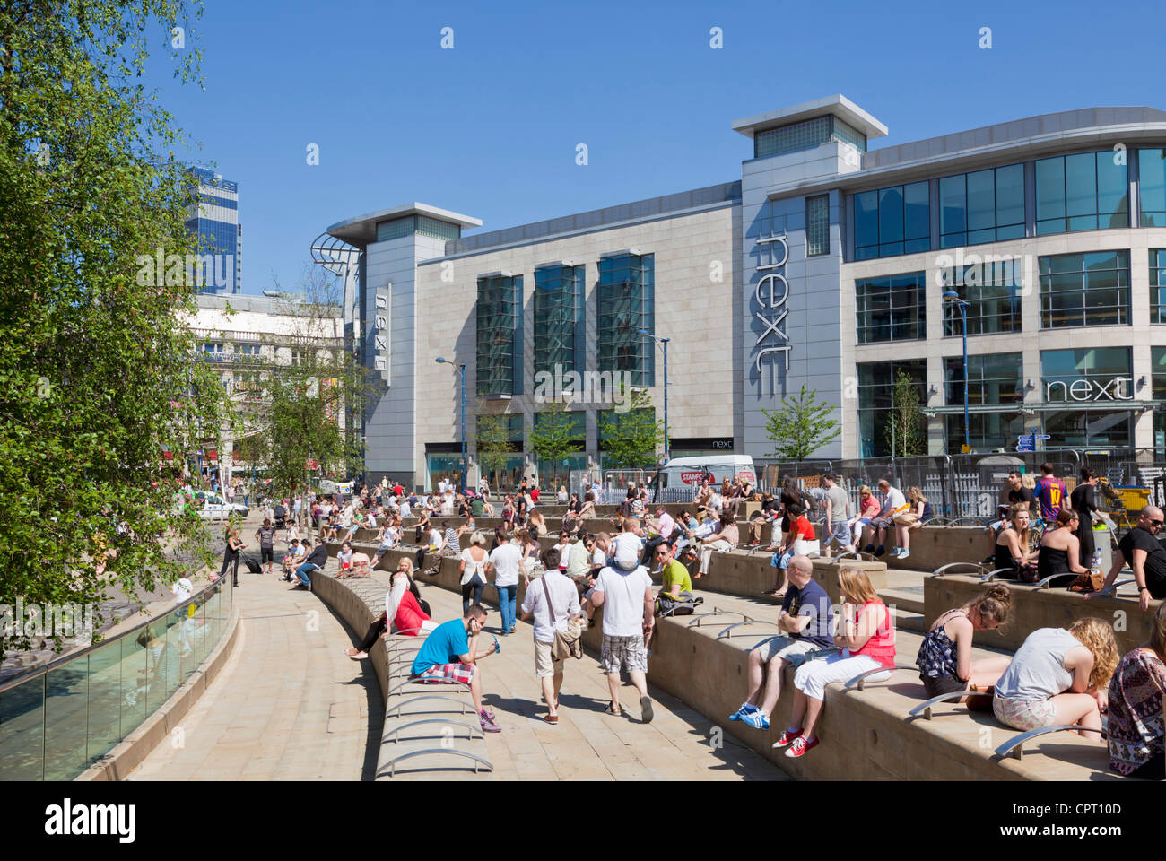 Crowds of shoppers outside Next store at the Arndale centre Manchester City Centre England UK GB  Europe - Stock Image