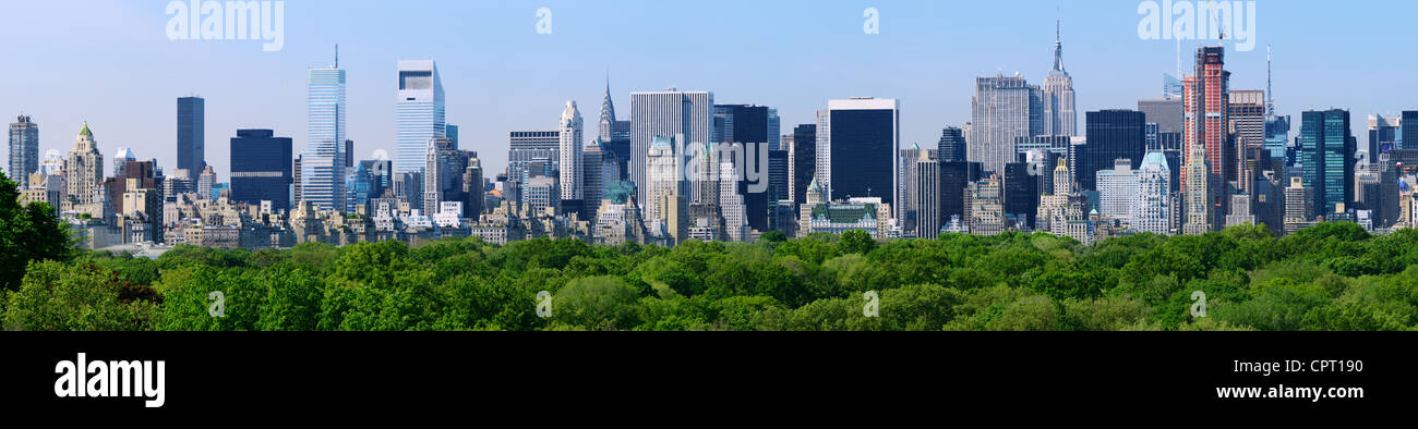 Panorama of midtown Manhattan from above Central Park treetops in New York City - Stock Image