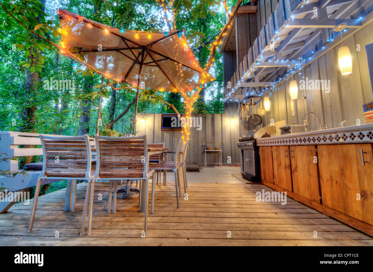 Nice home back porch in the woods - Stock Image