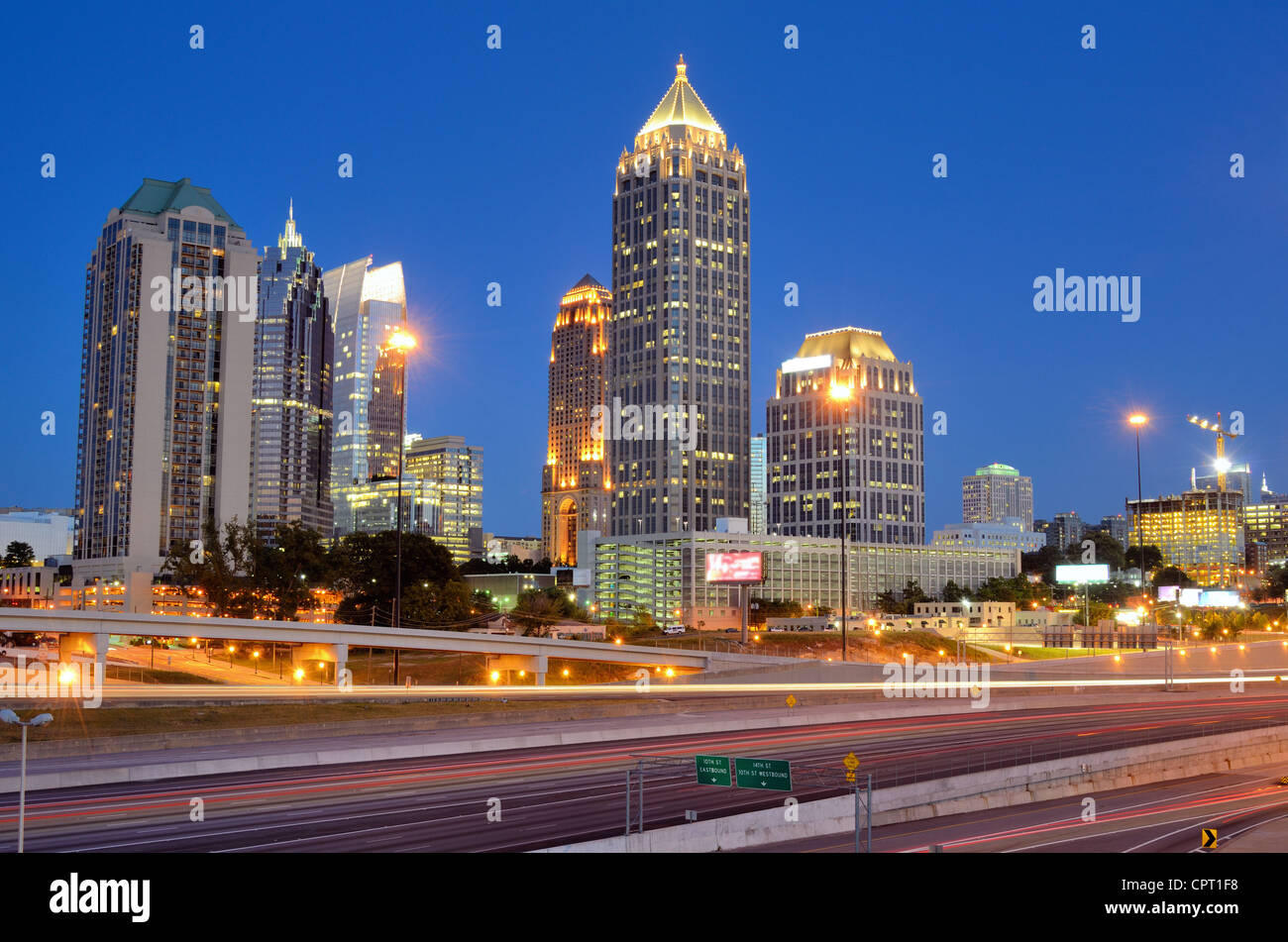 Interstate 85 runs below the skyline of Midtown Atlanta, Georgia, USA. - Stock Image