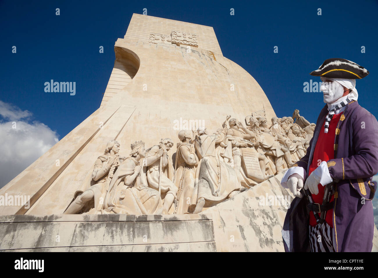 Monument to the Discoveries and man in period costume, Lisbon, Portugal - Stock Image