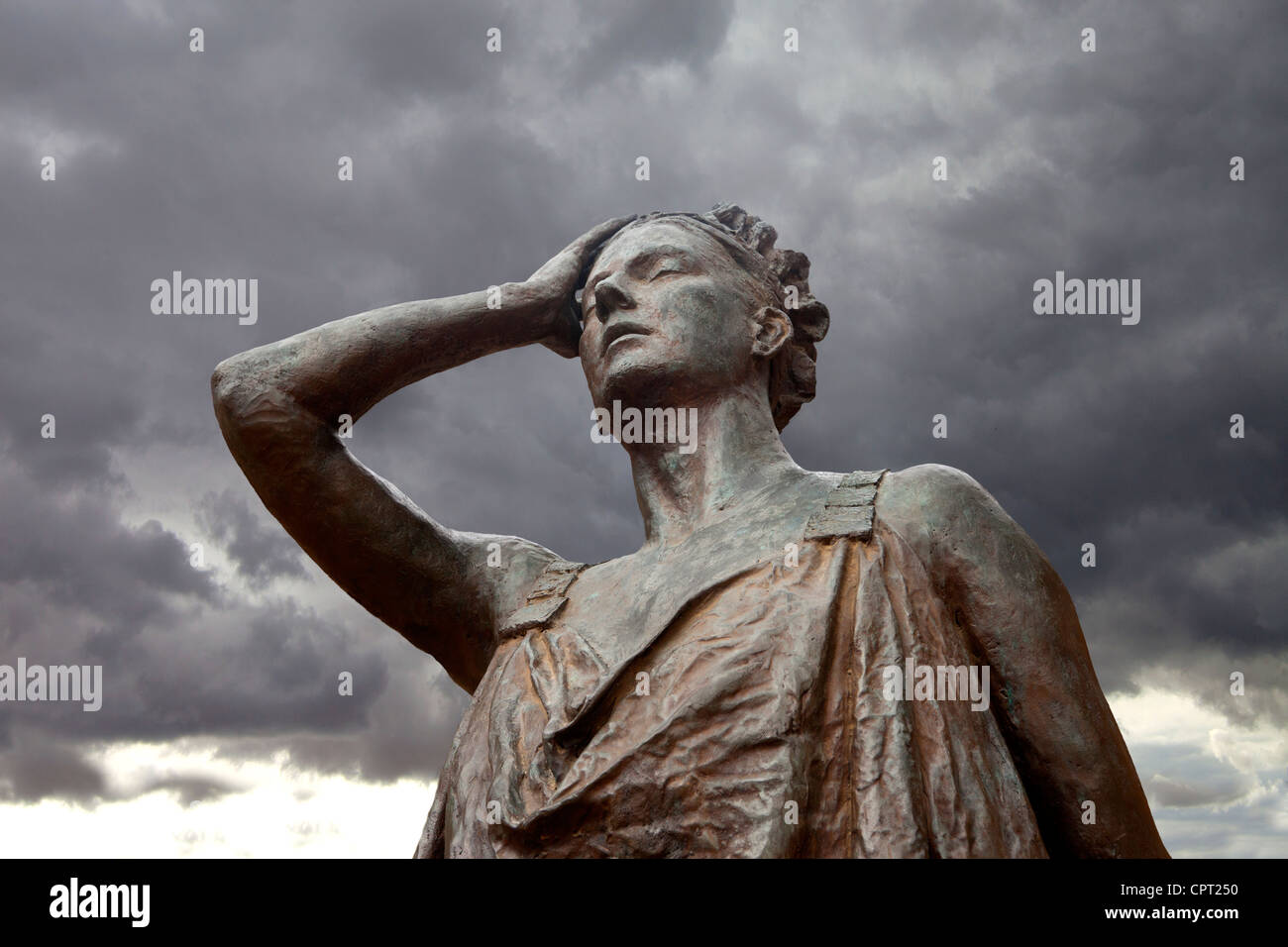 Modern bronze statue in the Roman ruins of Merida, Spain - Stock Image