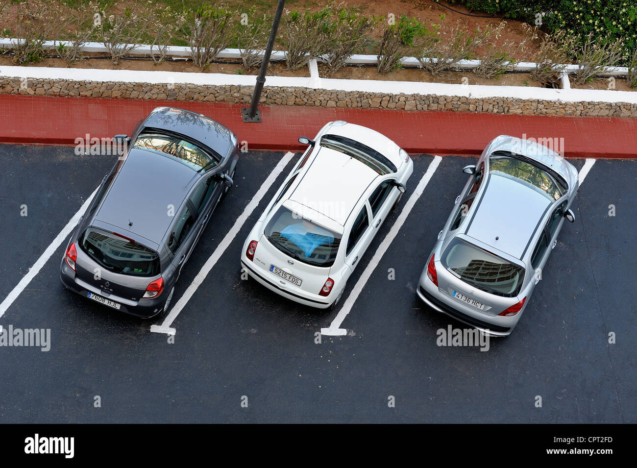 3 hire cars parked in a hotel car park arenal d'en castell menorca Balearic islands spain - Stock Image