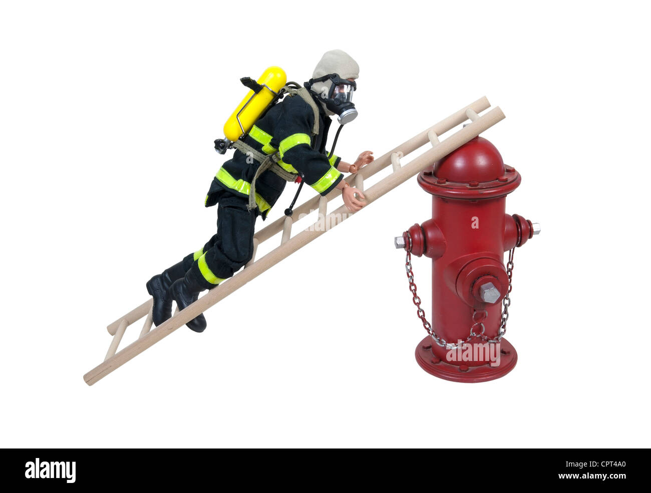 Fireman in protective gear climbing a ladder leaning on a fire hydrant - path included - Stock Image
