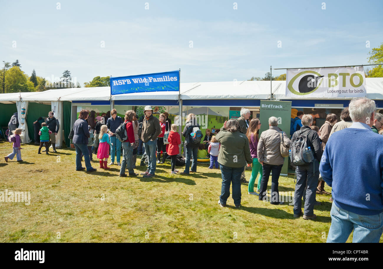 Visitors peruse the RSPB and BTO stalls at the Scottish Bird Fair in the grounds of Hopetoun House near Edinburgh - Stock Image