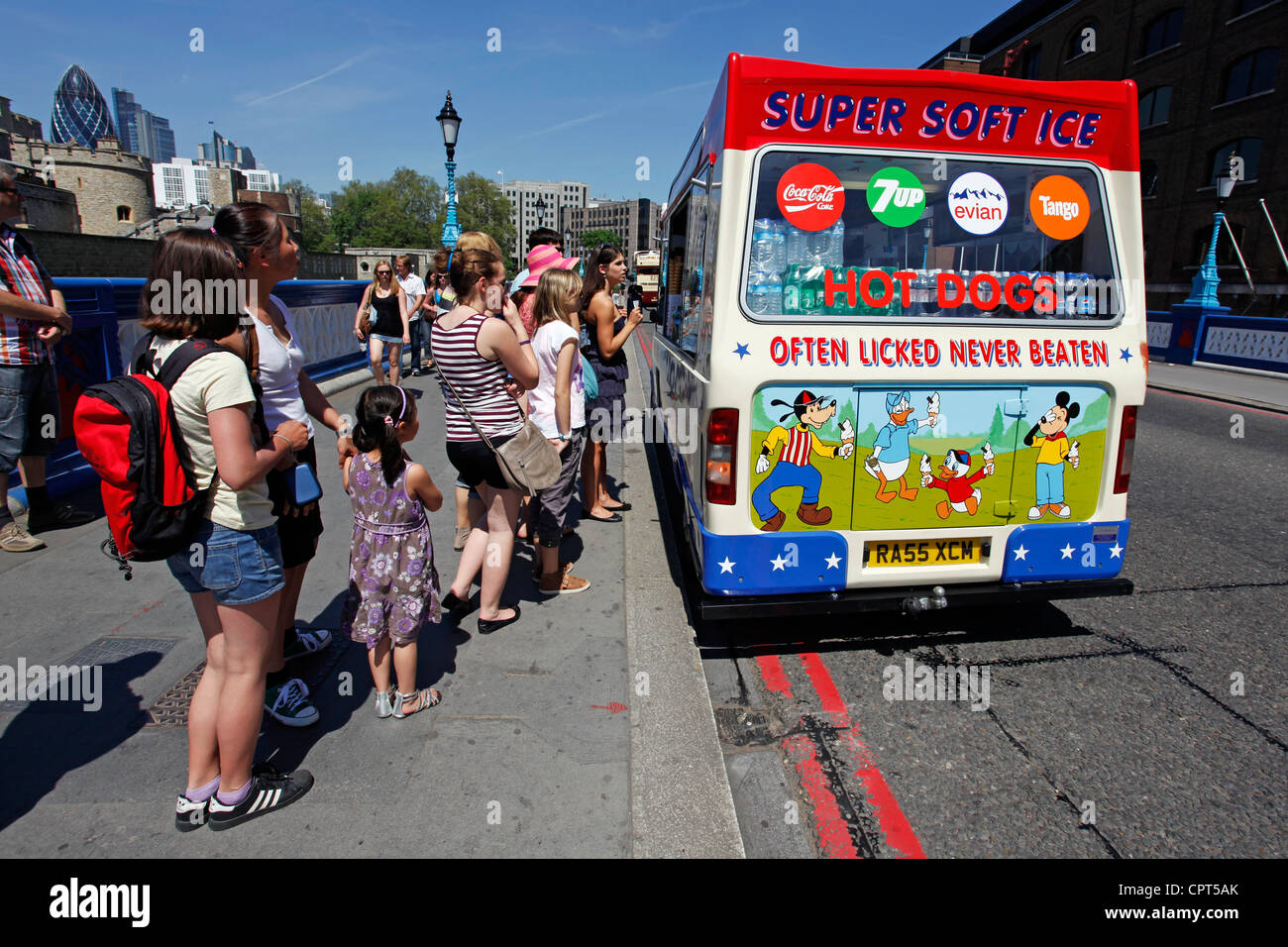 Selling ice creams to a queue of people at an Ice Cream Van, London, England - Stock Image