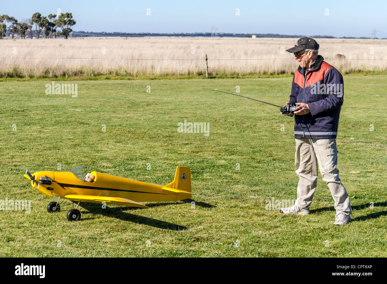 Man about to take off Radio Control RC airplane flying hobby Stock