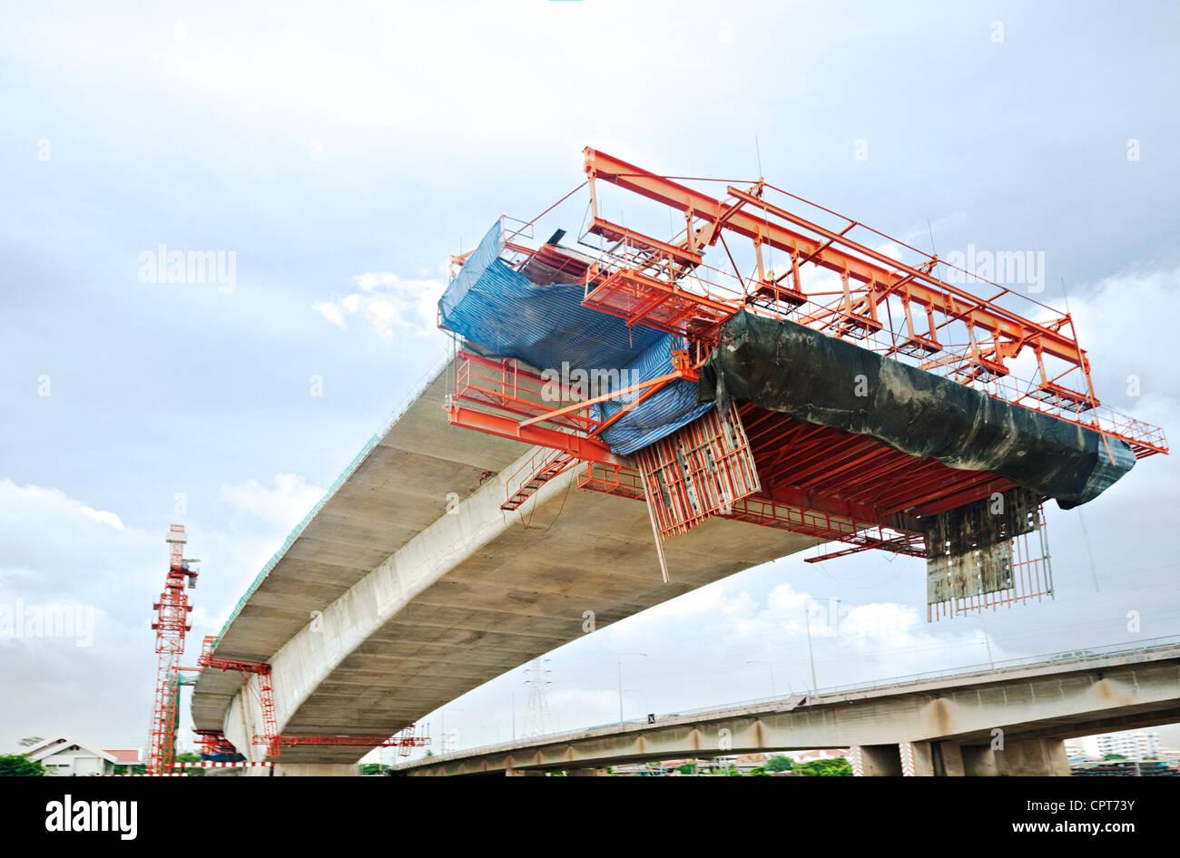 Bridge under construction in Bangkok, Thailand, viewed from below. - Stock Image