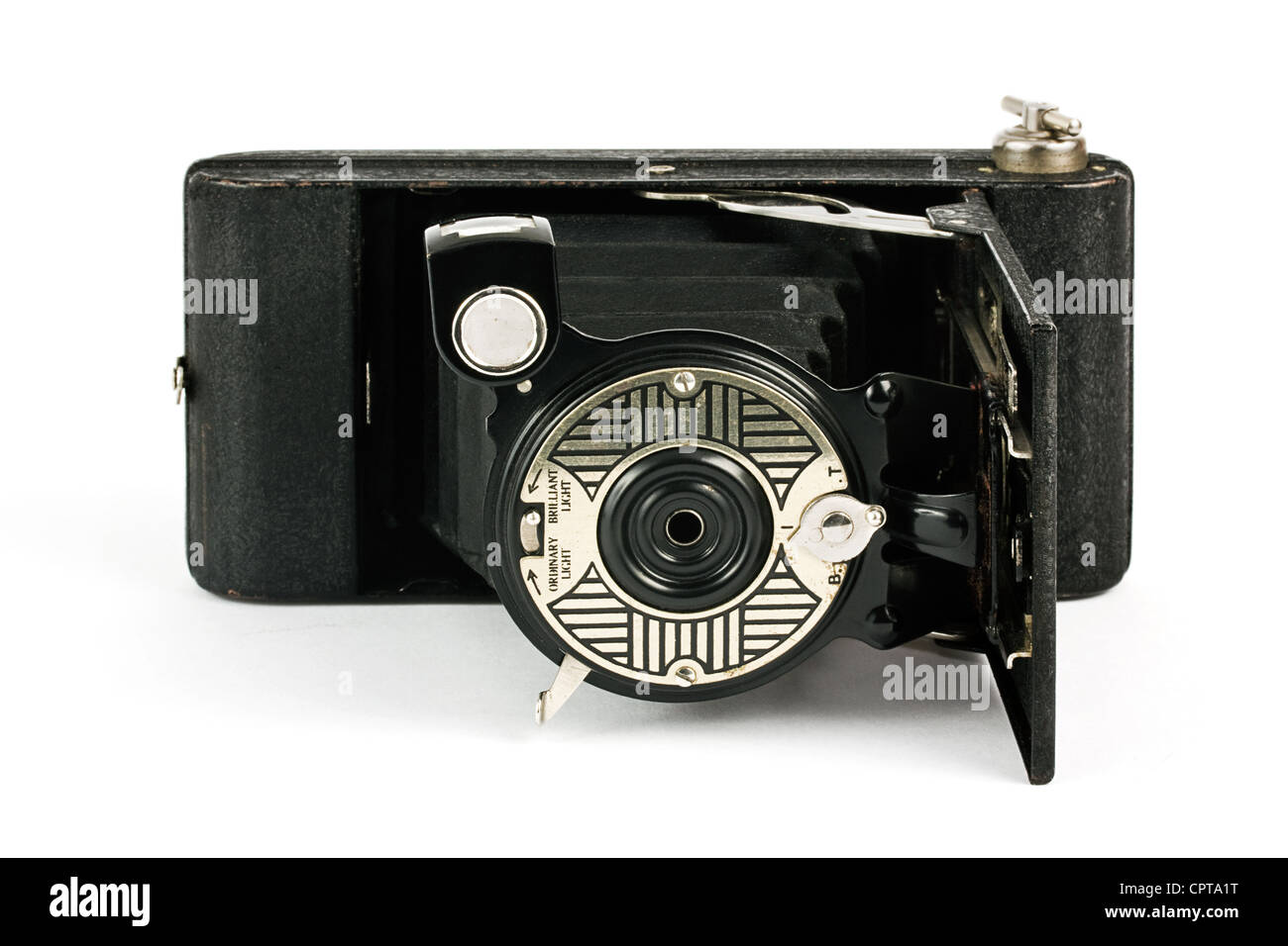 Antique fold away camera on a white background - Stock Image