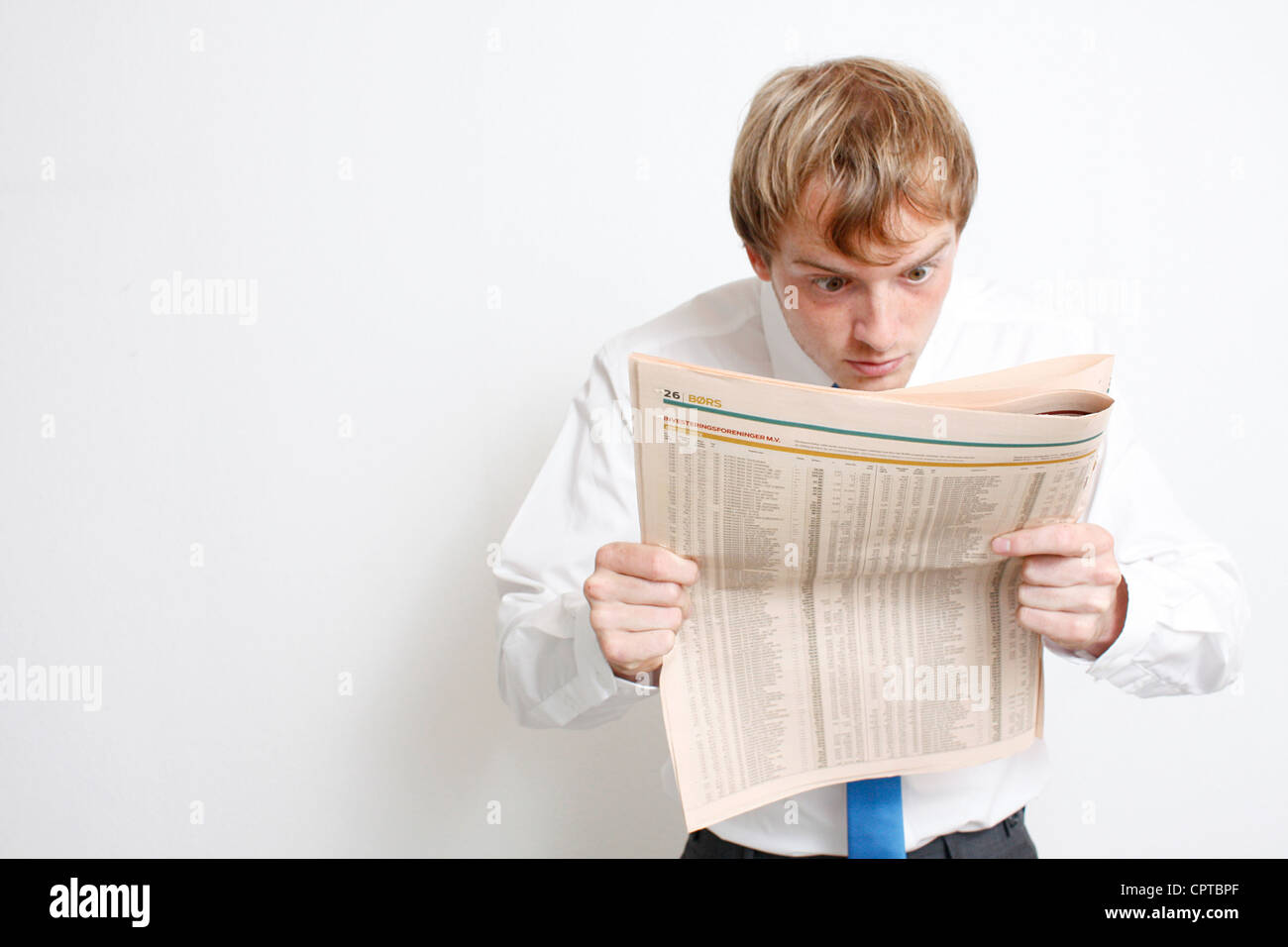 An annoyed junior business man - Stock Image