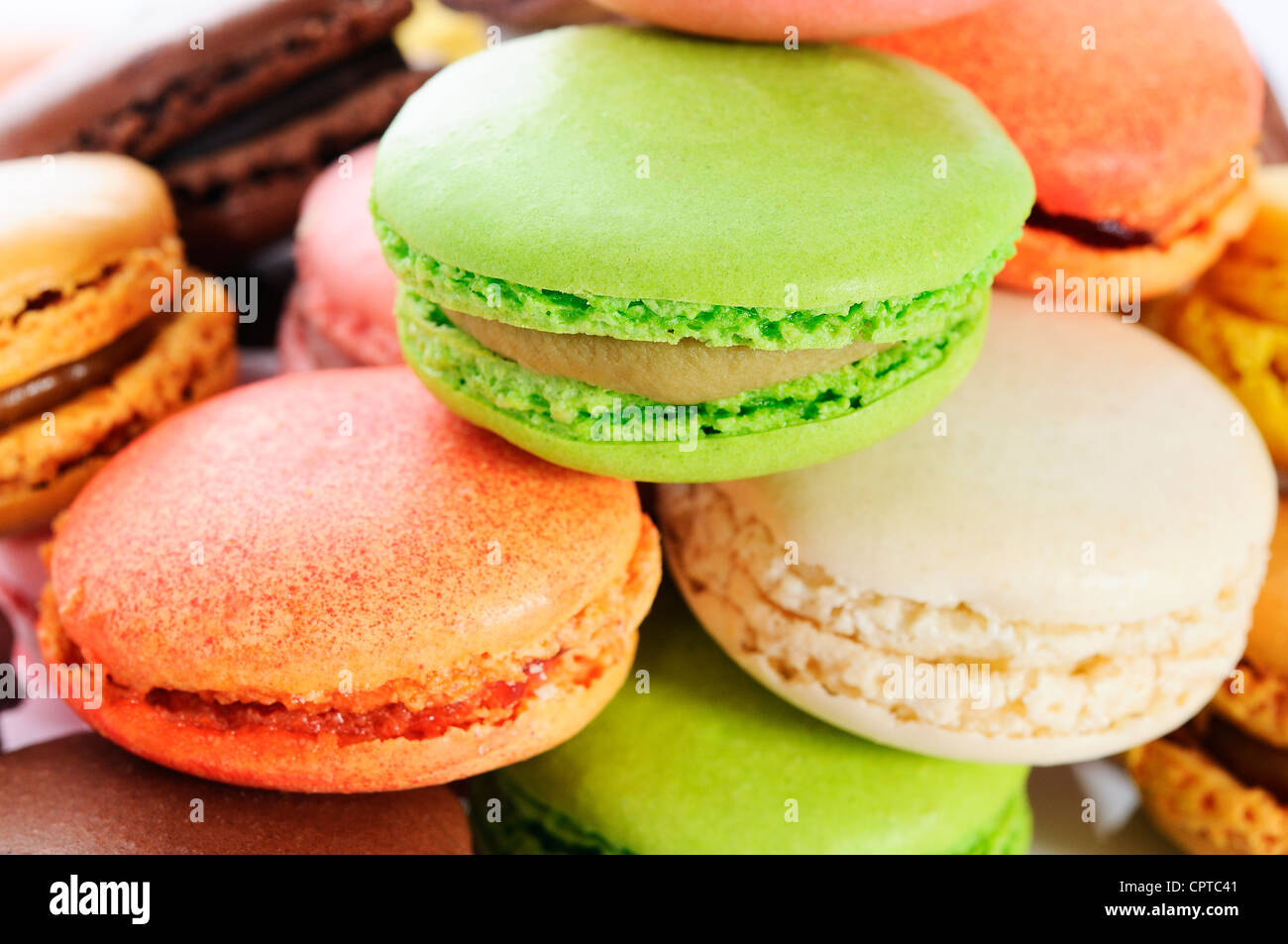 Colorful macaroons on white background - Stock Image