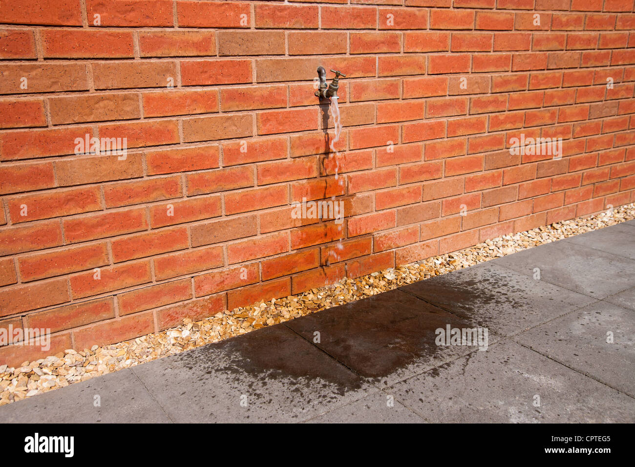 Outdoor tap with running water - Stock Image