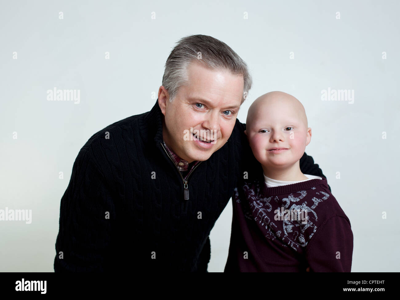 Father and son with Down's Syndrome, portrait - Stock Image