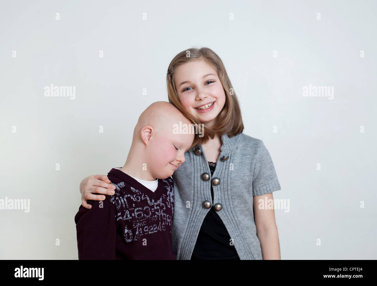 Sister brother with Down's Syndrome, studio shot - Stock Image