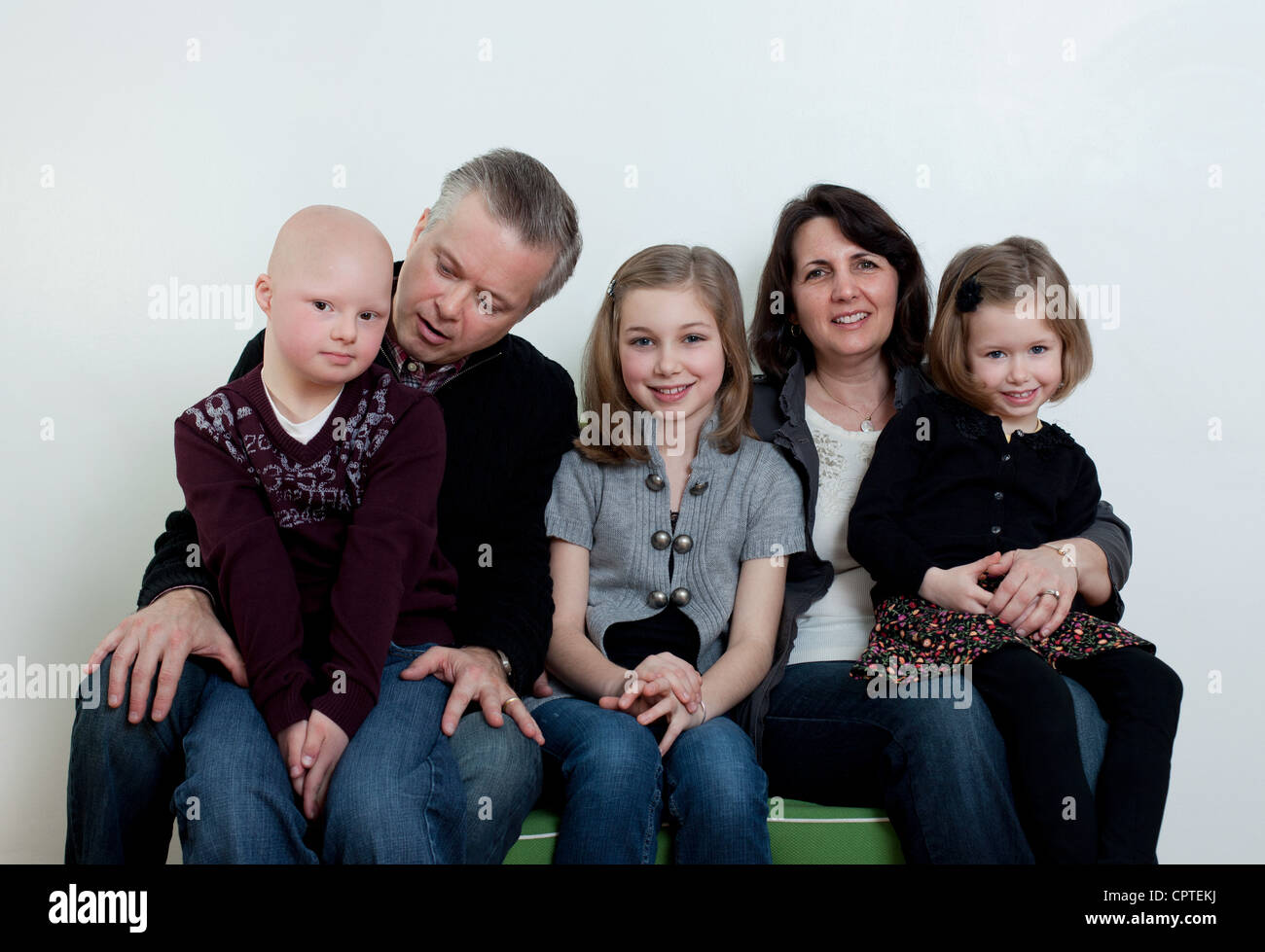 Family portrait with two daughters and son with Down's Syndrome - Stock Image