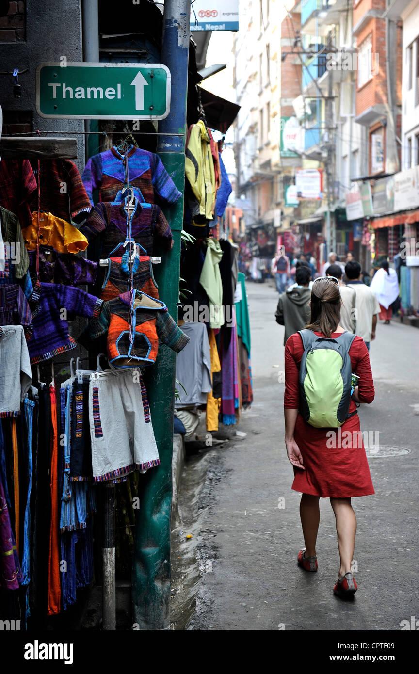 Woman tourist walks down the street of Thamel in Kathmandu, Nepal - Stock Image
