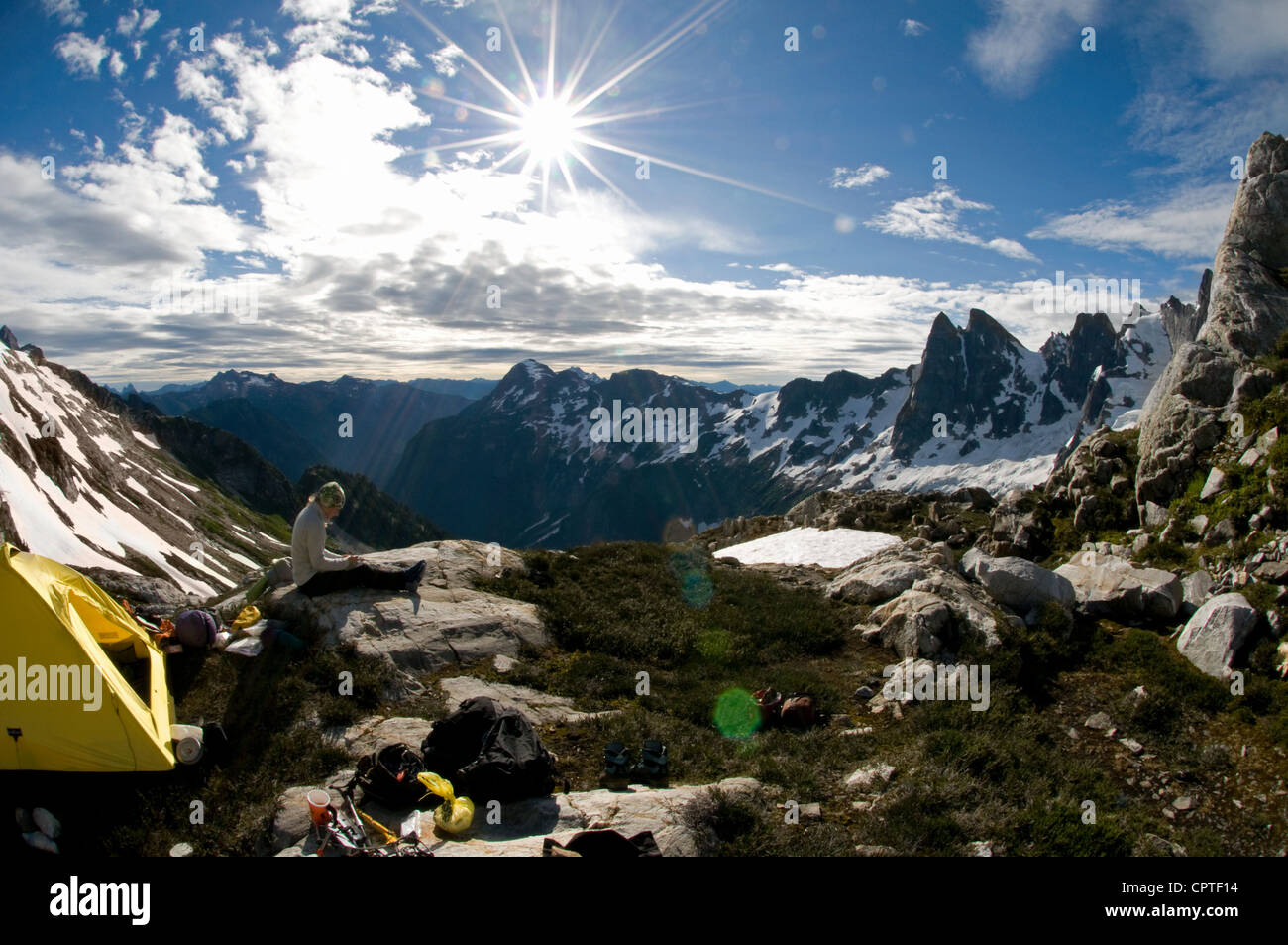 Backpacker at mountain camp, Picket Pass, North Cascades National Park, WA, USA - Stock Image