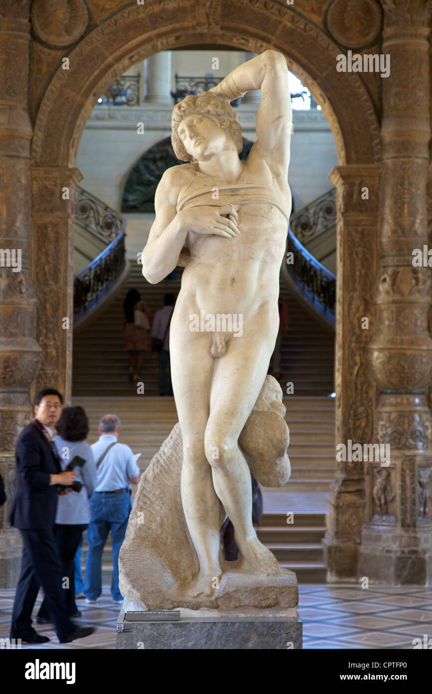 Dying Slave, marble sculpture, by Michelangelo, 1513-1516, Musee du Louvre Museum, Paris, France, Europe - Stock Image