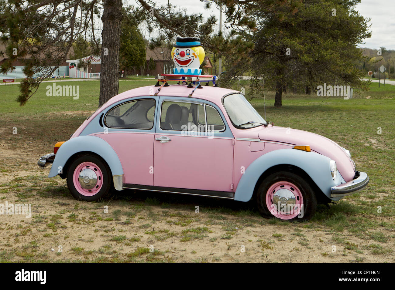 Old Pink Volkswagen Beetle With A Clown Head On Top At The Cherry