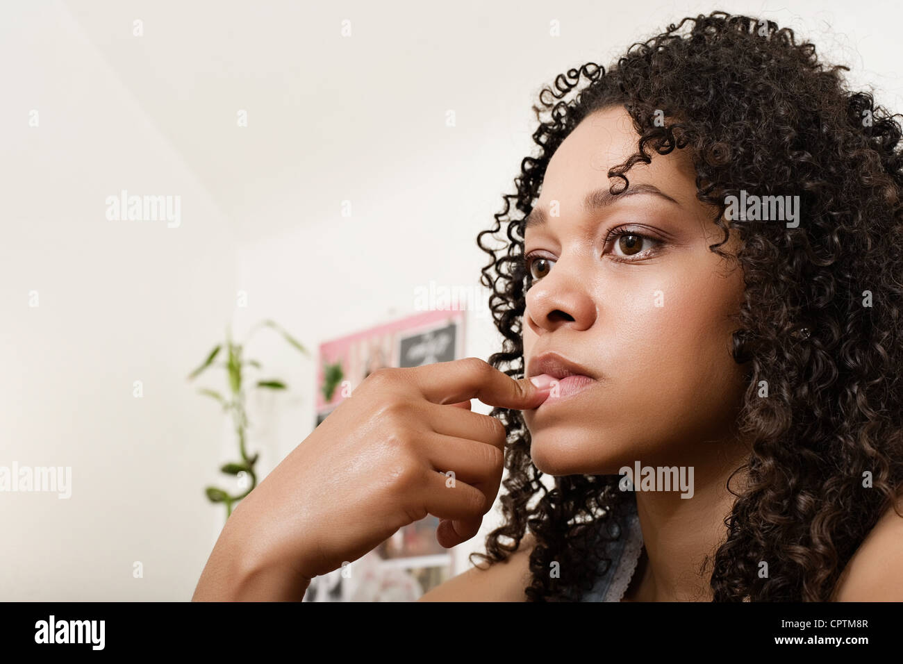 Young woman looking worried - Stock Image