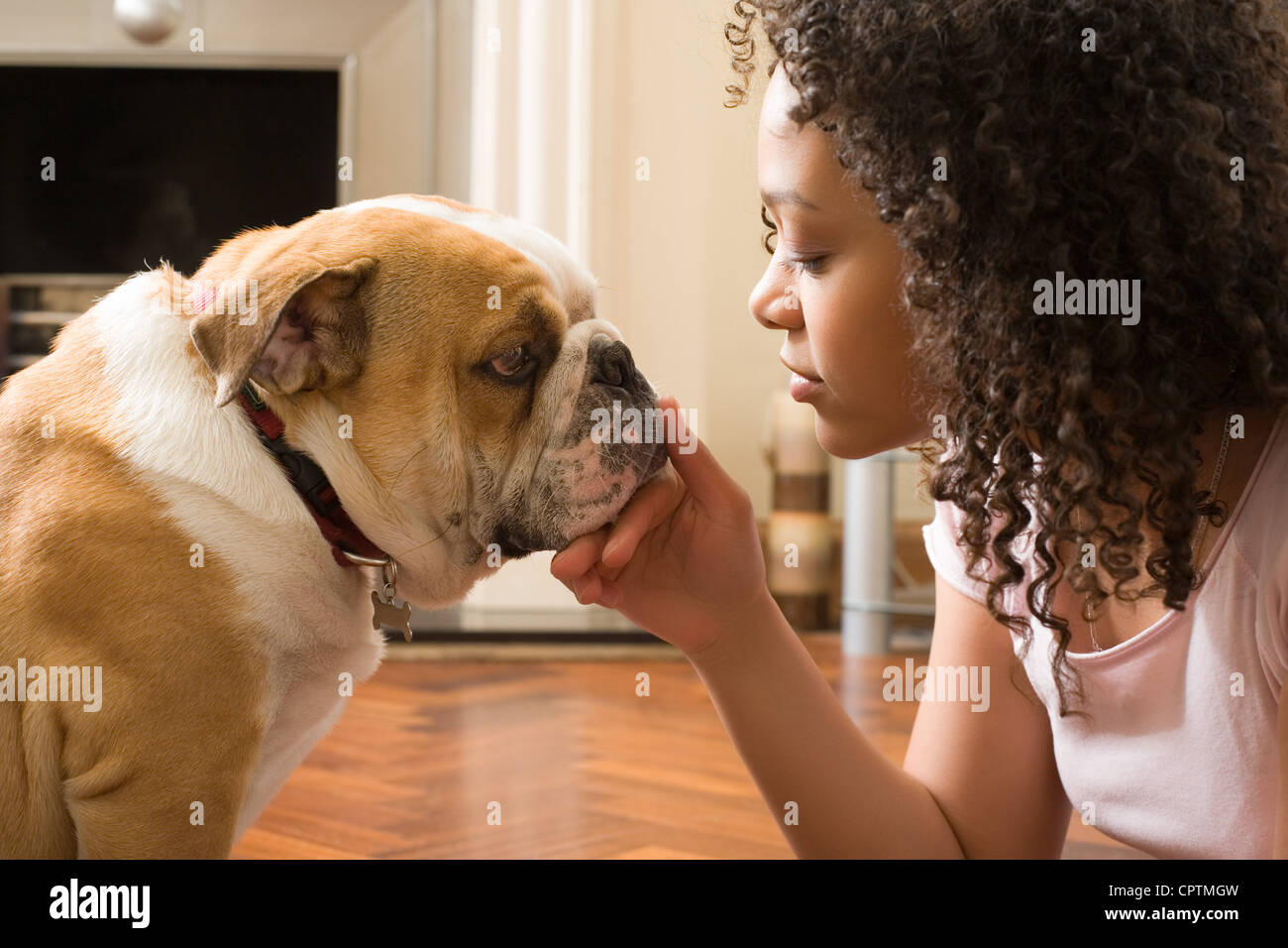 Young woman playing with her puppy dog - Stock Image