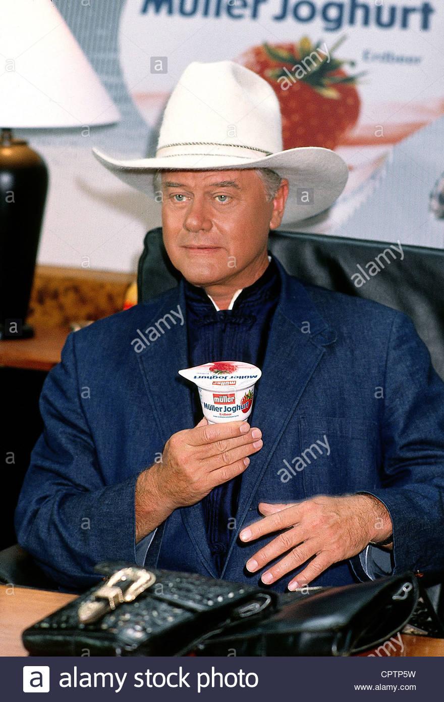 Hagman, Larry, * 21.9.1931, US actor, half length, advertising for German Mueller yogurt, 1980s, yoghurt, cowboy, - Stock Image