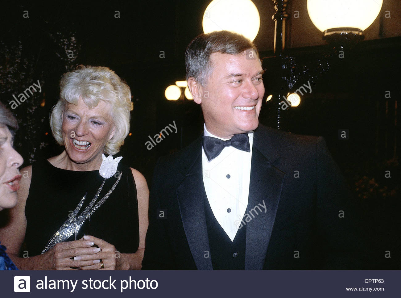 Hagman, Larry, * 21.9.1931, US actor, portrait, with his wife Maj Axelsson, at a party, Munich, 1982, dinner jacket - Stock Image