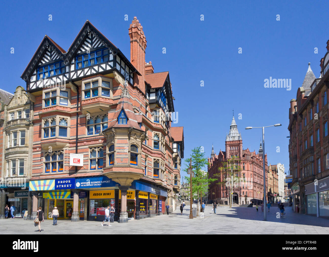 Shops in the city centre junction of King street and Queen Street Nottingham Nottinghamshire East Midlands England - Stock Image