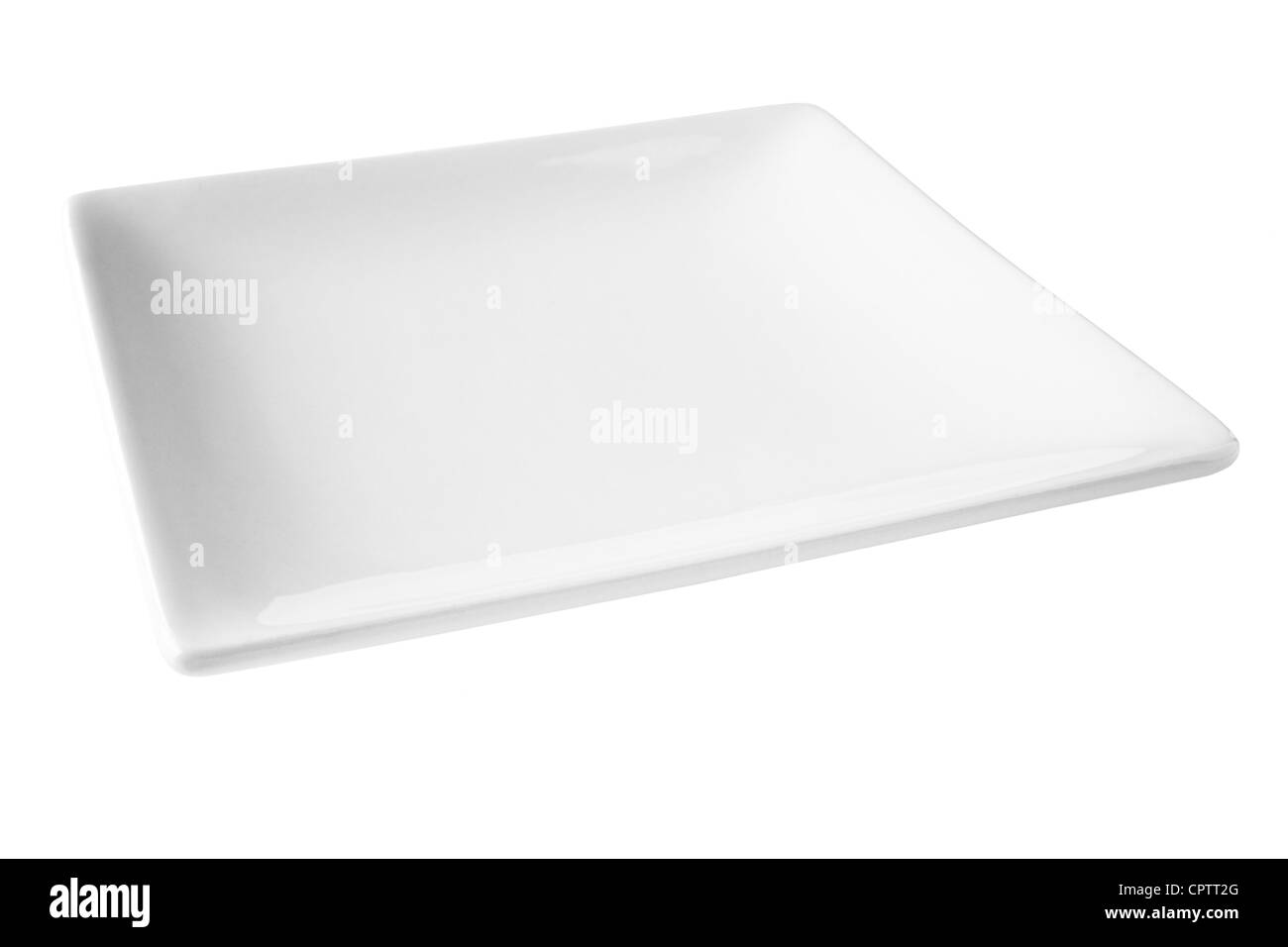 Square white porcelain plate, set at an angle, isloated on white and with clipping path included. - Stock Image