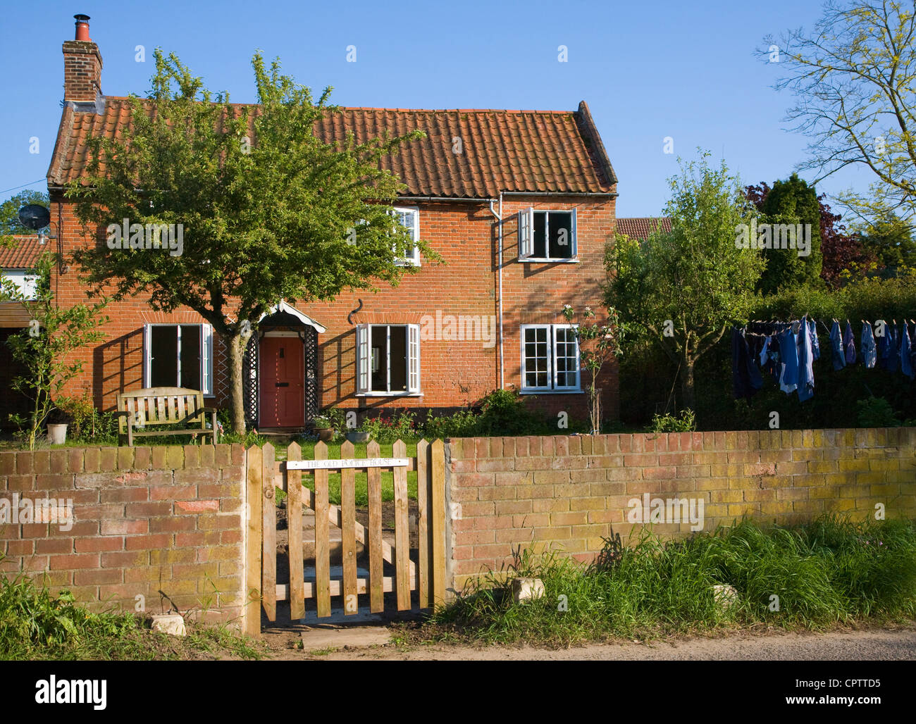 Property released ( photographer's home) detached house with garden wall and gate, Shottisham, Suffolk, England Stock Photo