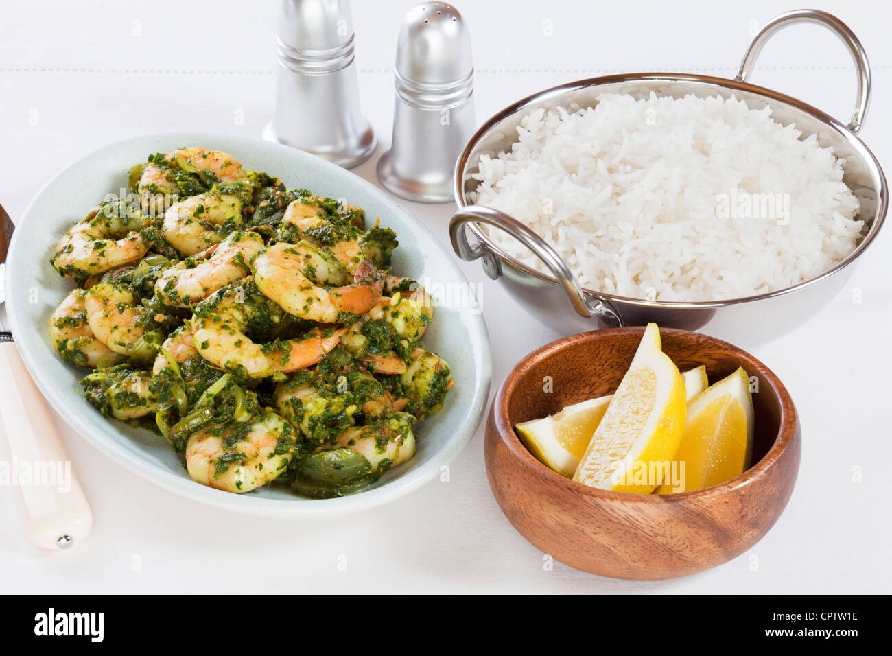 Indian curry prawn saag or sag is made with pureed spinach, here served with basmati rice and lemon. Stock Photo