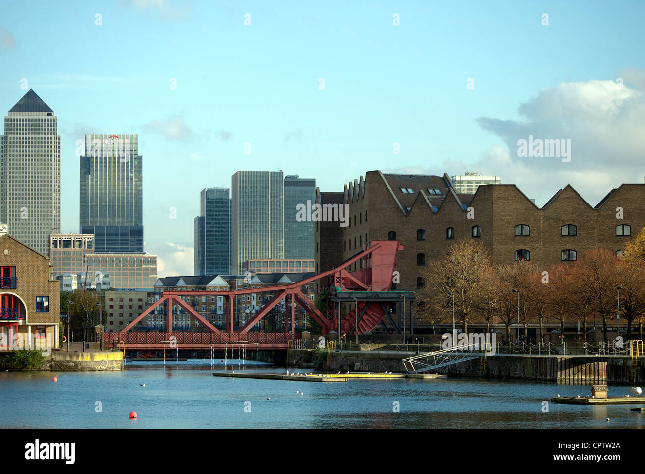 Shadwell Basin with Canary Wharf in the background, East London, UK - Stock Image