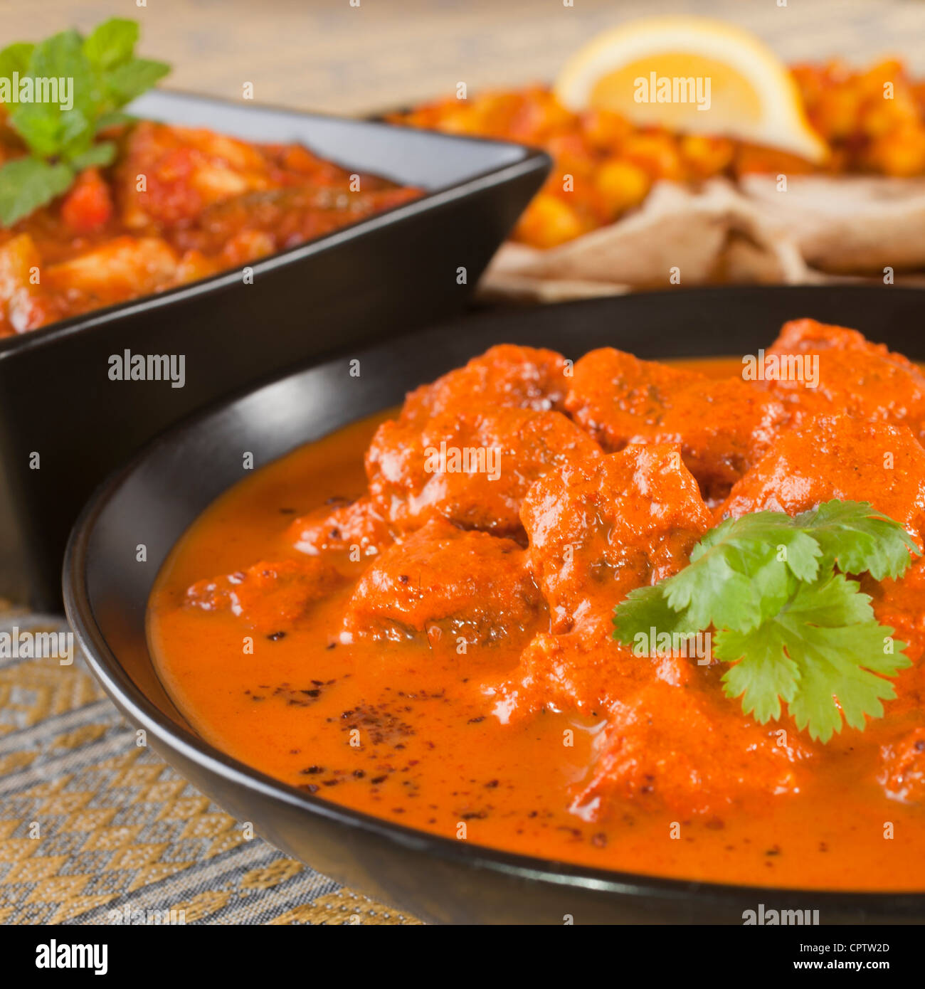Favourite Indian curry Rogan Josh with chapatis and channa dhal, and chicken jalfrezi. - Stock Image
