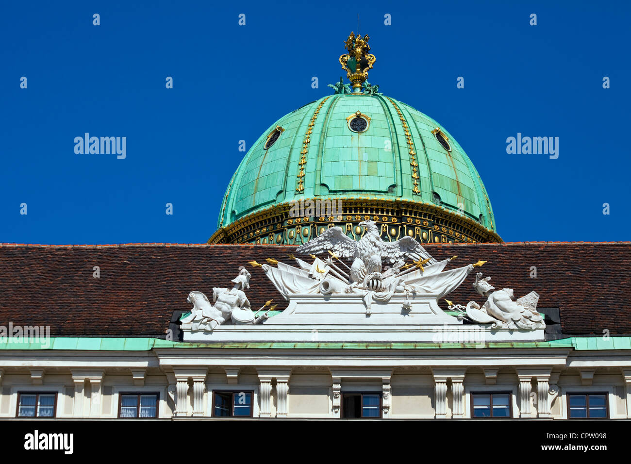 Dome and Decoration over the Michaeler Gate of the Hofburg Palace in Vienna - Stock Image