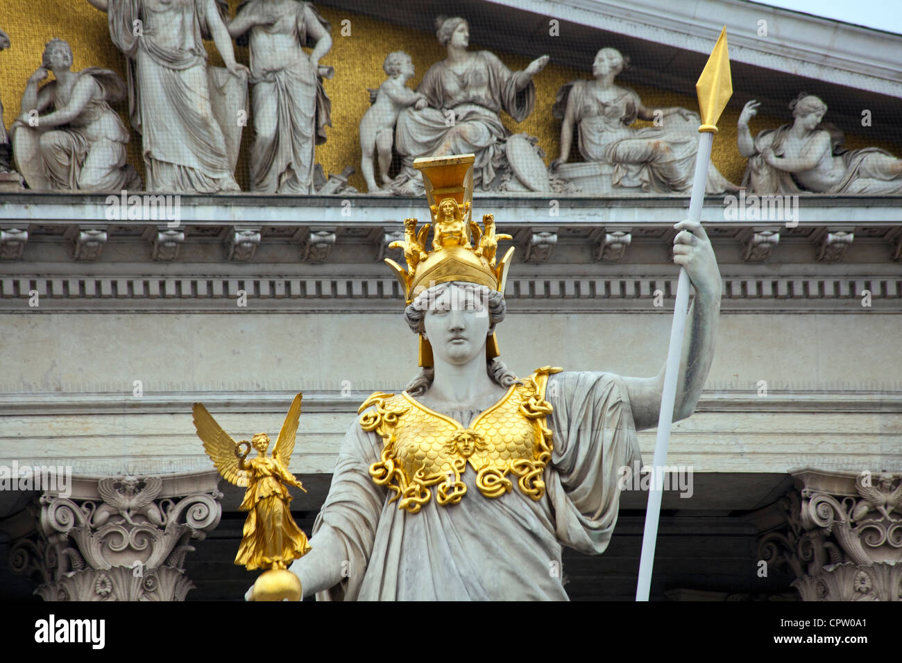 Pallas Athene Statue of of the goddess of Wisdom with Goddess NIke in her hand outside the parliament in Vienna - Stock Image