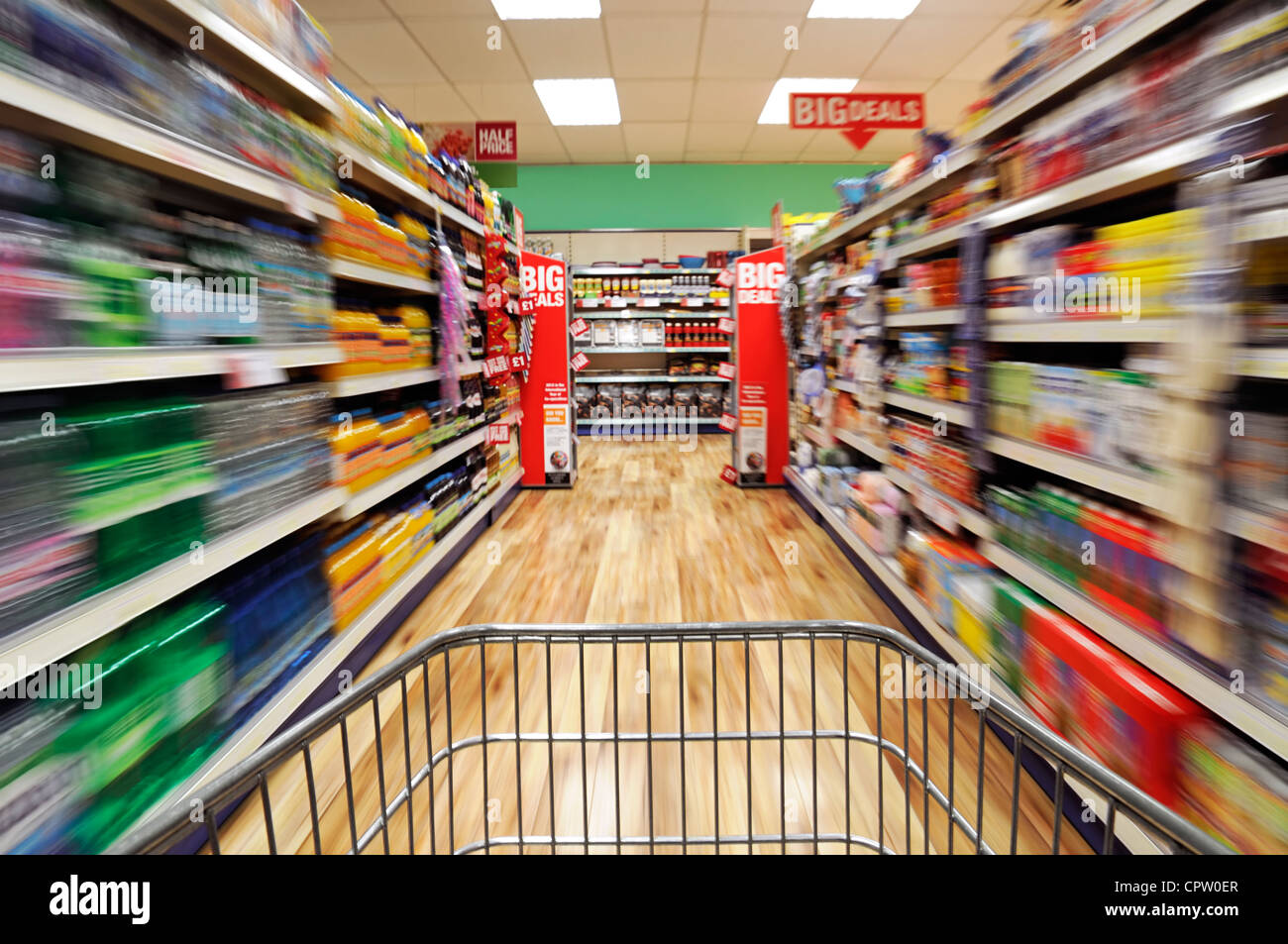 Shopping Trolley Speeding Down a Supermarket Aisle, UK. - Stock Image