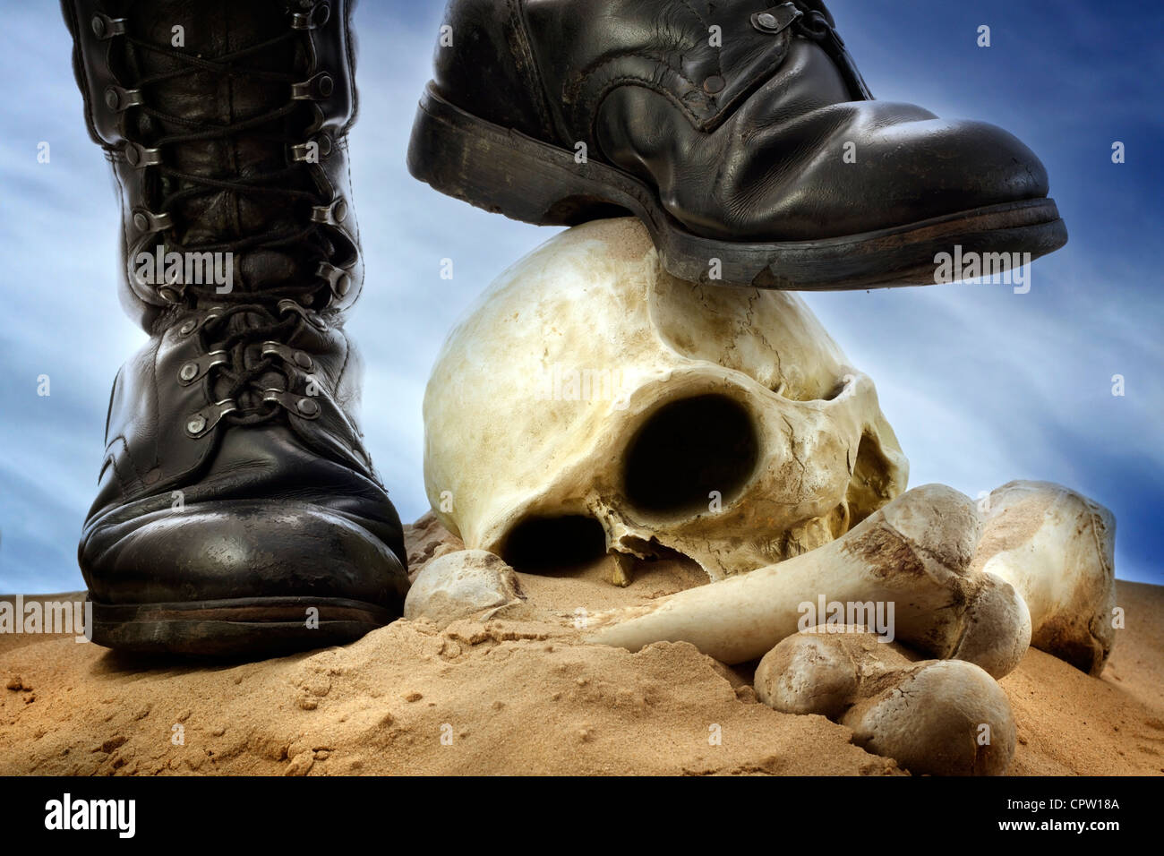 Military shoes , skull and bones cruelty of war winners and losers - Stock Image