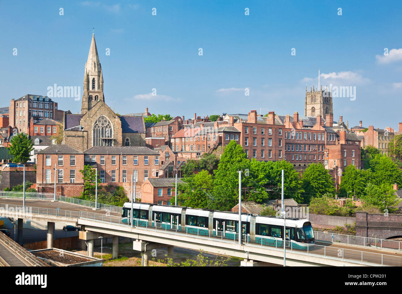 Nottingham tram crossing a bridge travelling from Nottingham city centre Nottinghamshire England UK GB EU europe - Stock Image