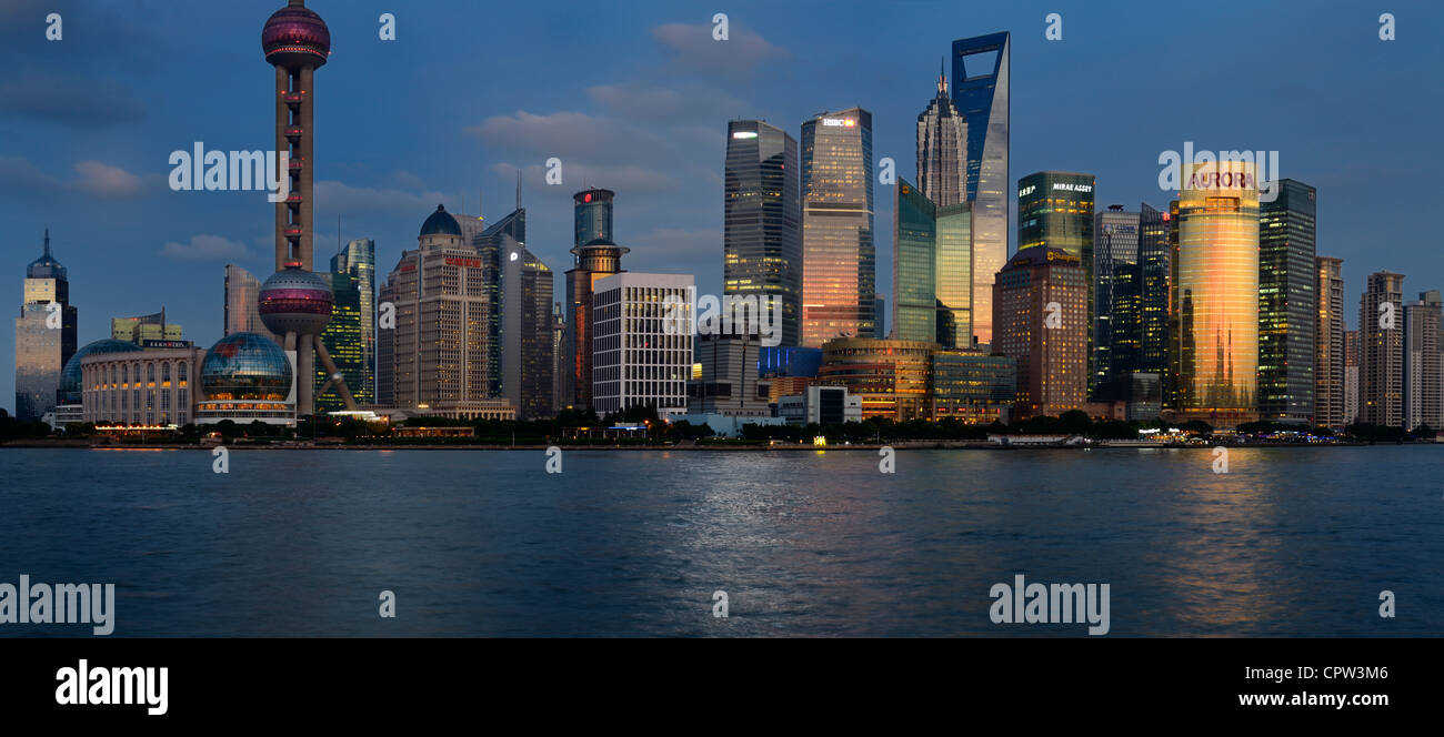 Panorama at dusk red glow on high rise financial towers and hotels in the Pudong east side of Shanghai China - Stock Image